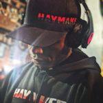 Man wearing Haymaker headphones and hat