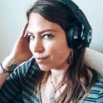 Woman wearing Haymaker headphones