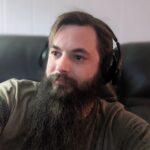 Man with long beard wearing Haymaker headphones